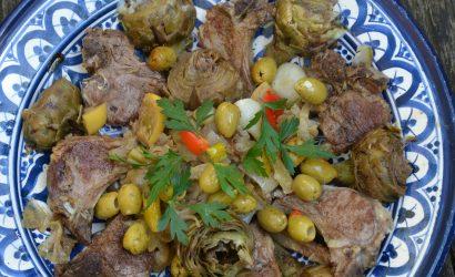 Tajine côtelettes d'agneau, artichauts, olives et citrons confit